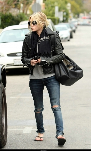 Ashley Olsen pairs ripped jeans with couture hanbags