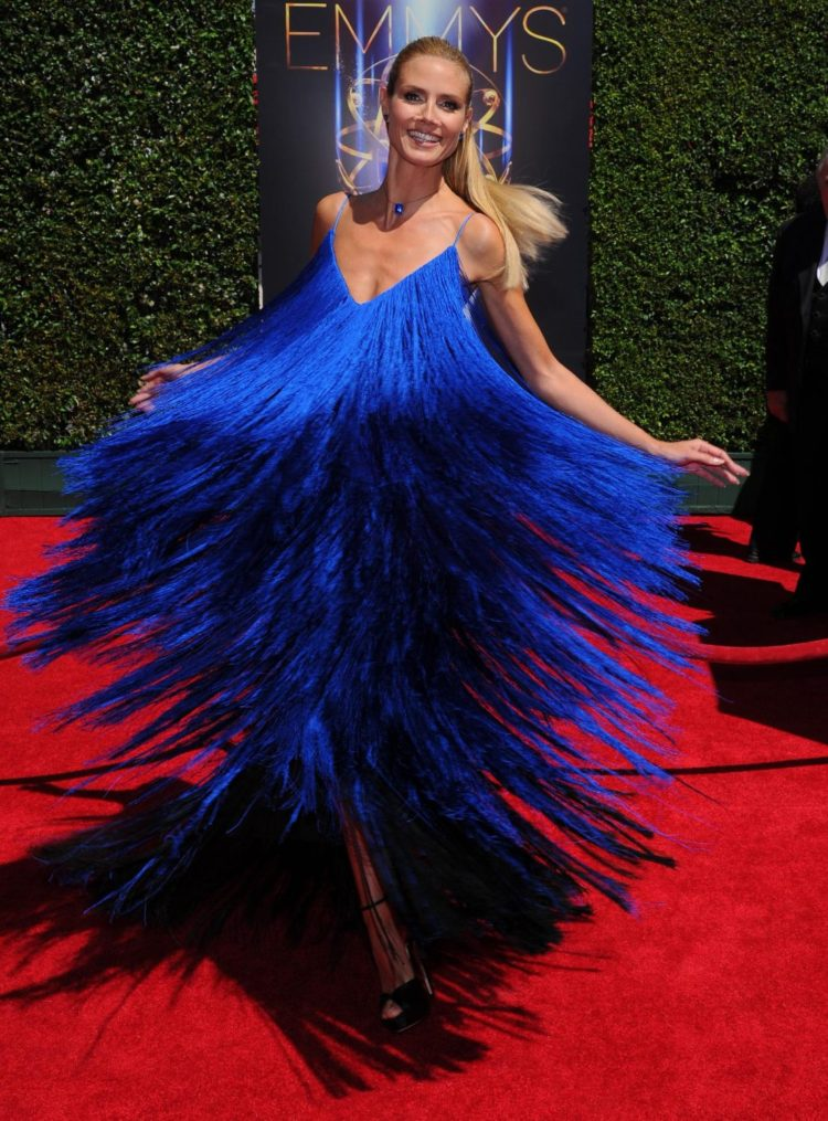 The supermodel rocked the fringe trend to the max in a blue floor-length Sean Kelly gown that complemented her blonde locks.