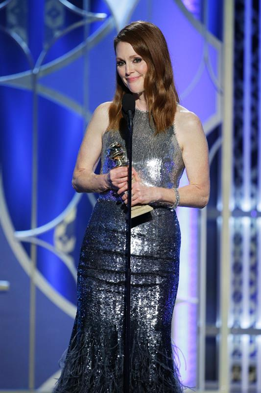 """72nd ANNUAL GOLDEN GLOBE AWARDS -- Pictured: Julianne Moore, """"Still Alice"""", Winner, Best Actress - Motion Picture, Drama at the 72nd Annual Golden Globe Awards held at the Beverly Hilton Hotel on January 11, 2015 -- (Photo by: Paul Drinkwater/NBC)"""