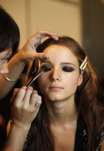 model-getting-her-makeup-done-backstage-at-just-cavalli-spring-2010-milan-fashion-week