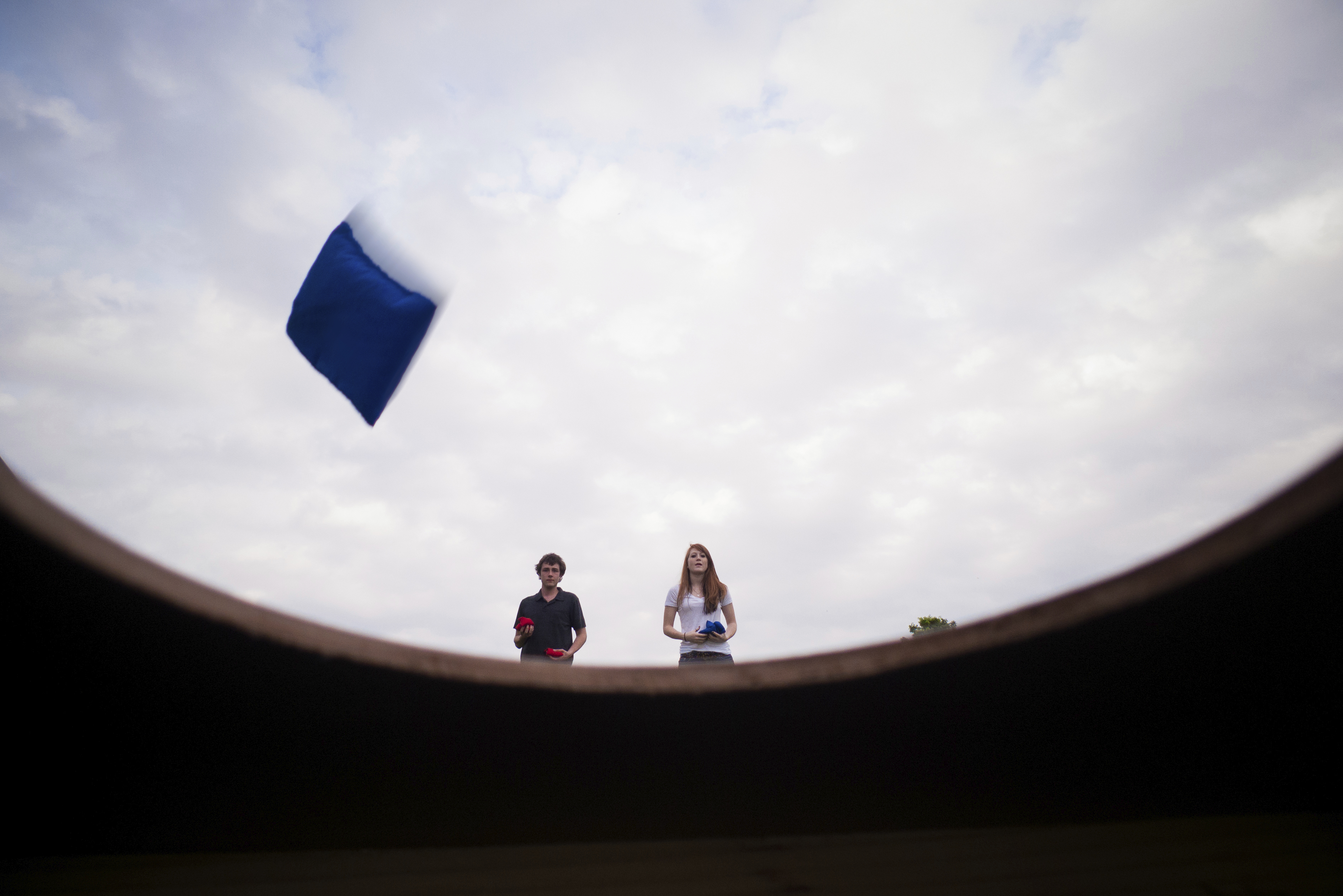 Boy and girl playing beanbag toss at park