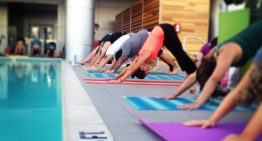 Spend Summer Nights at LUSTRE's Rooftop Yoga Series