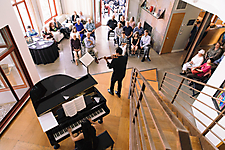Christina Rodrigues and Karen Nguyen perform salon concert in central room of Neil Giuliano home