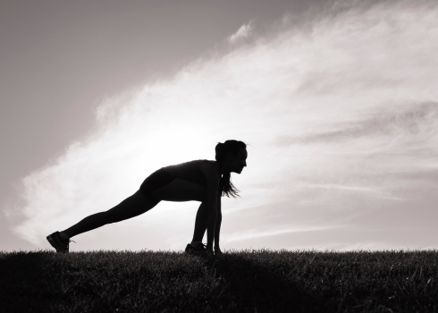 Woman stretching before her morning run