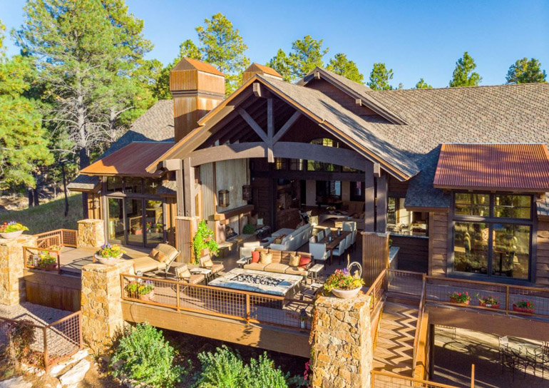 Flagstaff, this rustic contemporary estate is the optimum of true indoor-outdoor living with all of the main living spaces completely opening up to the largest deck in all of Pine Canyon, $3,100,000.jpg