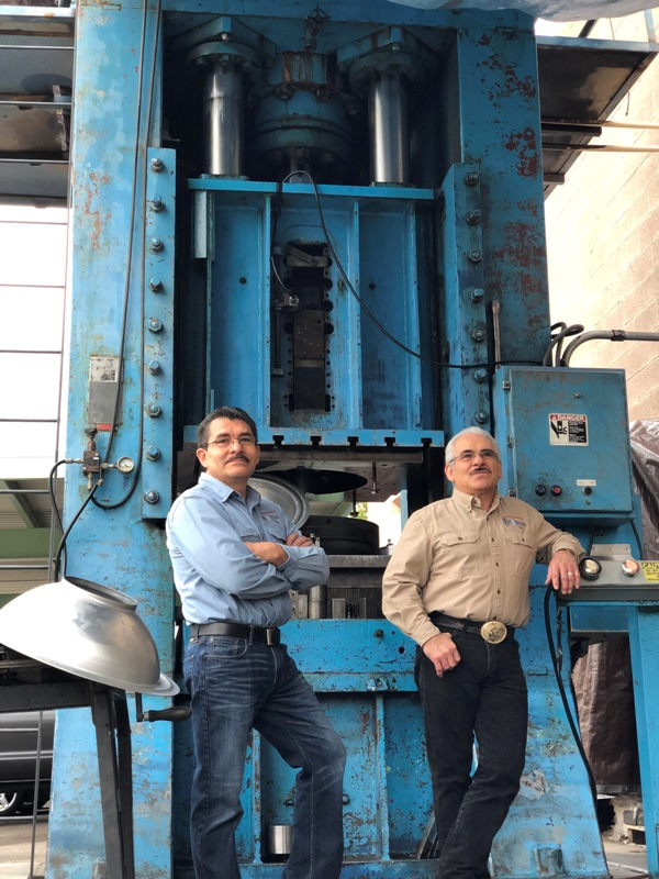 Saul and Juan Estrada left to right at 350-ton hydraulic press. Photo Saul Estrada Jr_.jpg