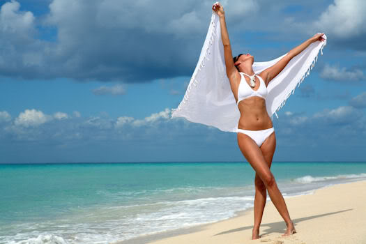 woman-dancing-on-beach-shutterstock 8739688
