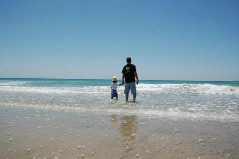 Does it get any better than this?  Father and son hand and hand on the beach in Rocky Point.