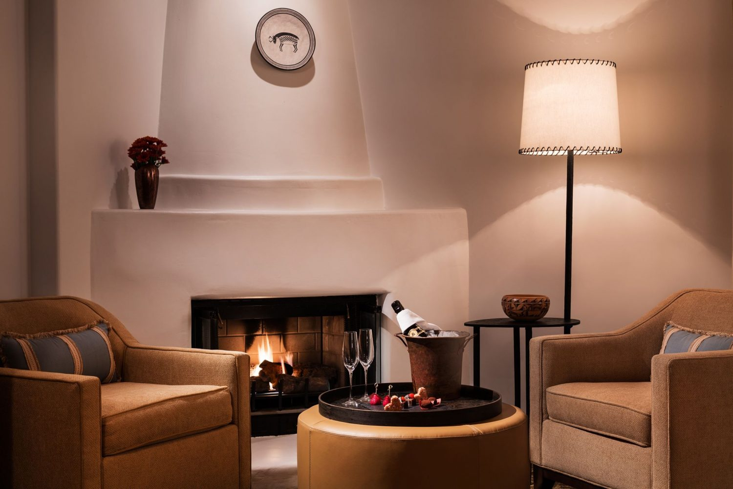 Rosewood inn of the anasazi unveils new luxury guestrooms for Kiva fireplaces