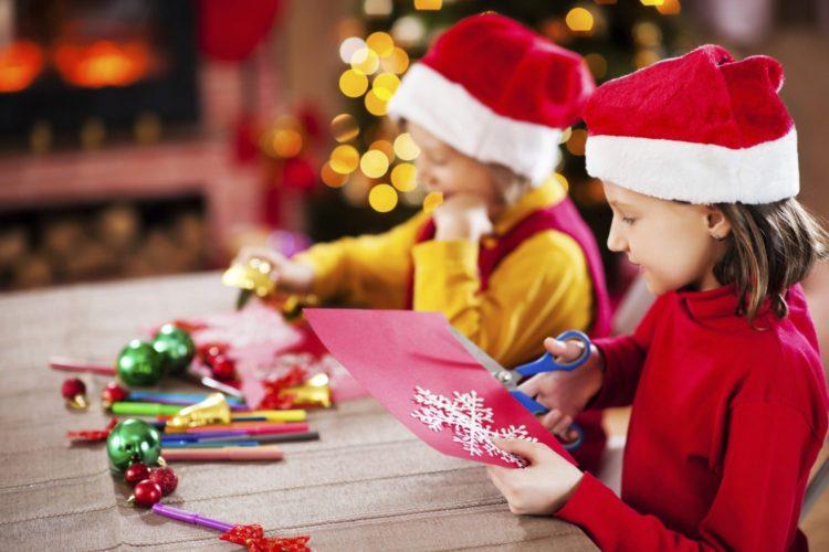 Beautiful kids making Christmas cards.