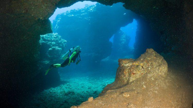 B659FX Diver at Caves of Lava Tubes Cathedrals of Lanai Maui Hawaii USA