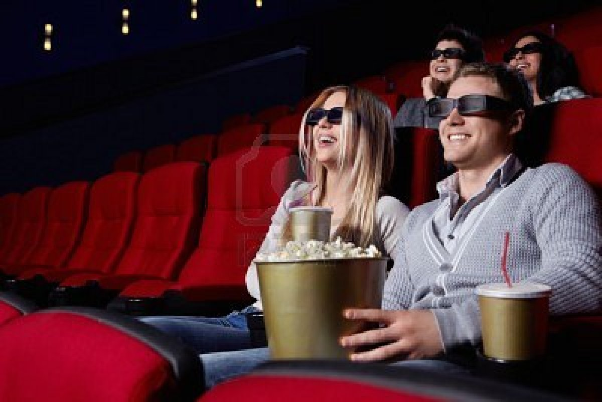 9326659-laughing-young-people-in-3d-glasses-watching-a-movie-at-the-cinema.jpeg