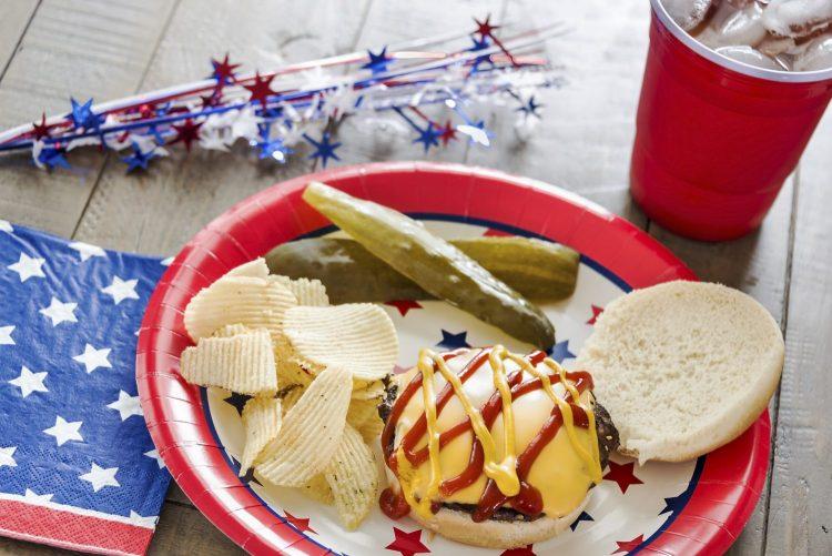 Cheeseburger with ketchup and mustard and a patriotic theme