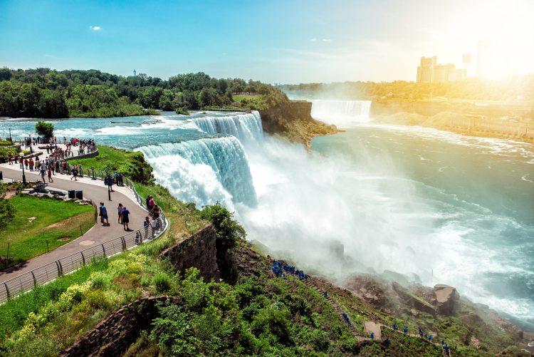 Tourists enjoying beautiful view to Niagara Falls during sunny day