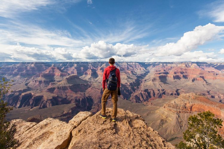 Travel in Grand Canyon, man Hiker with backpack enjoying view, USA