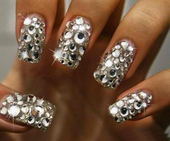 Using different sized jewels is a unique way to style one's nails ...