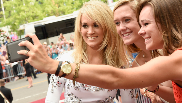 NASHVILLE, TN - JUNE 10:  Carrie Underwood (L) attends the 2015 CMT Music awards at the Bridgestone Arena on June 10, 2015 in Nashville, Tennessee.  (Photo by Rick Diamond/Getty Images  for CMT)