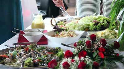 stock-footage-woman-taking-some-salad-at-a-buffet